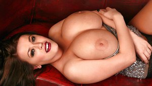 Pinup model Leanne Crow flaunting large all natural breasts up close