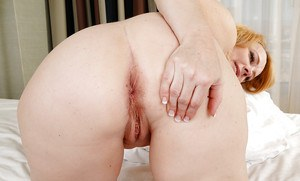 Chunky lady Brandie Sweet sliding panties to one side for cunt baring