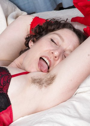Aged solo model Artimesia showing off sexy granny legs and hairy pussy