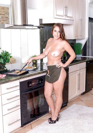 Busty MILF Skyler showing off fat ass and large natural breasts in kitchen