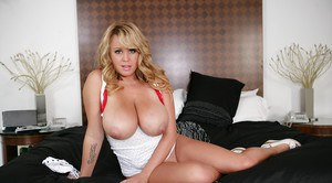 Chesty blonde model releases her massive all natural juggs from blouse