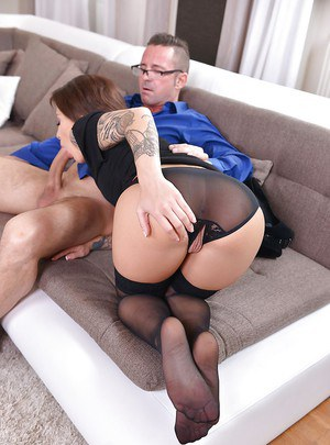 Fully clothed Italian babe Nikita Bellucci jacking dick with hose clad feet