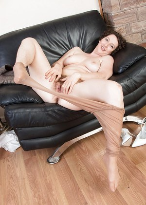 Aged woman Artimesia poses in pantyhose while expose hairy bush and legs