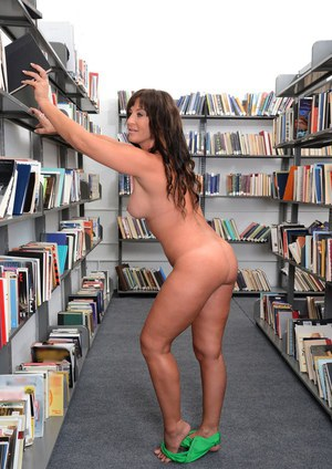 Clothed MILF Brandi Fox stripping naked to bare butt in library