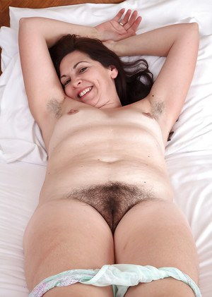 Mature lady Francesca spreading hairy pussy up close after panty removal