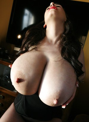 Chesty centerfold babe September Carrino releasing huge hooters and nipples