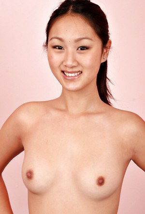 Young asian first timer Evelyn Lin spreading pussy after removing uniform