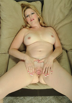 Close up with mature redhead Sable Knight undressing shaved pussy