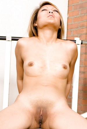 Hot Asian amateur Kandy baring tiny breasts and shaved pussy