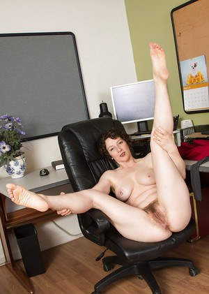 Older hirsute secretary Artimesia sliding hosiery over thong adorned butt