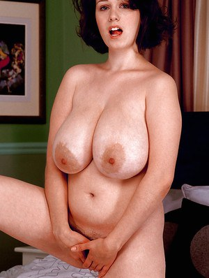 Brunette amateur Nicole Peters licking own nipples upon massive melons