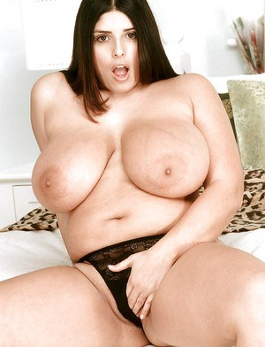 Plump MILF chick Kerry Marie bares massive melons for high heeled close ups