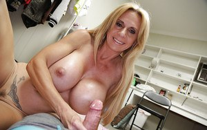 Chesty older blonde with big tits and hard nipples jerks oiled cock for cum