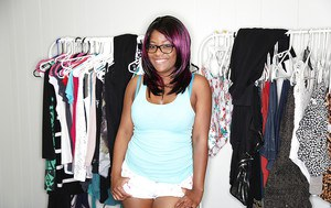 Ebony solo babe in glasses reveals panties and big butt while undressing
