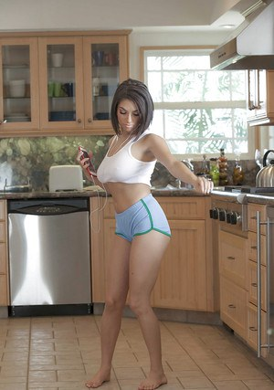 Clothed babe Darcie Dolce flashing big natural tits and nipples in kitchen
