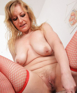 Aged blonde Susan stripping down to stockings for speculum insertion