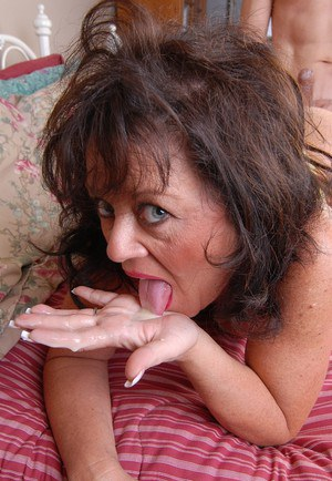 Aged brunette Debella eating jizz from hand after taking cumshot