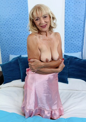Aged lady Janet Lesley masturbating shaved vagina with sex toy up close