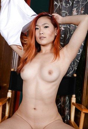 Amateur redheaded Asian babe Lea Hart revealing perfect tits and bald pussy