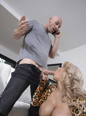 Chesty older blonde cougar Alyssa Lynn giving a blowjob on her knees