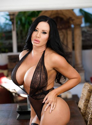 Brunette Latina MILF Sybil Stallone flaunting monster tits in stockings