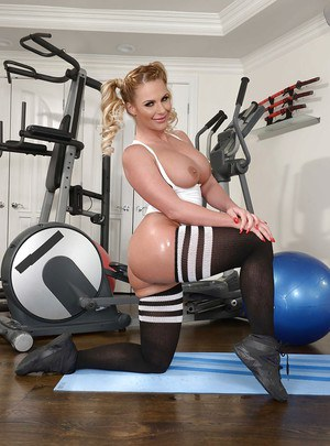 Sporty MILF Phoenix Marie showing off oiled booty in long socks and shoes
