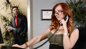 Redheaded office worker Dani Jensen giving a titjob at work in glasses