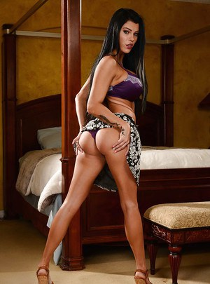 Buxom brunette wife Peta Jensen strips naked to show off phat ass and pussy