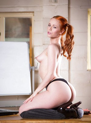 Redhead schoolgirl Ella Hughes posing in pigtails while revealing tiny tits
