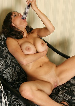 Aged brunette lady Harley Davis flaunting large tits while toying bald cunt