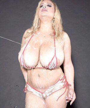 Buxom blonde MILF Liza Biggs shows off huge hooters after bukkake session
