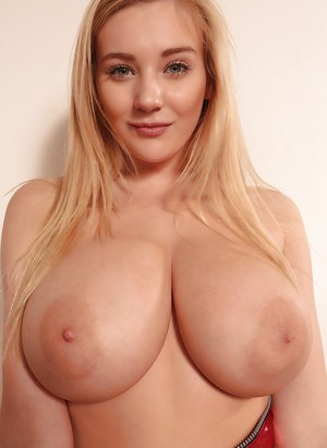 Blonde solo girl Beth Lily flaunting huge all natural tits on knees