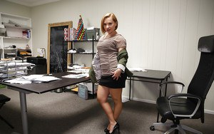 Mature European office lady undressing in office to reveal nice older boobs