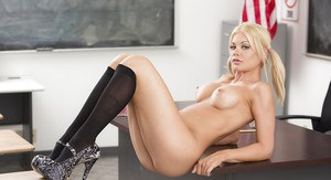 Blond solo girl Riley Steele flashing tight schoolgirl ass in thong panties