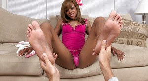 Barefoot black girl with great legs Jennifer Anderson giving a footjob