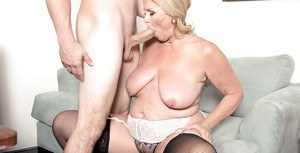 Plump over 60 blonde granny Alice blowing big cock in stockings
