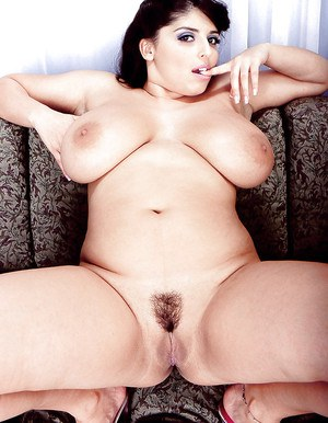 Chubby solo girl Kerry Marie showing off big hanging pornstar tits