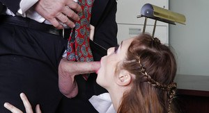 Pornstar Jessie Andrews licks nut sac and blows cock in office for cumshot