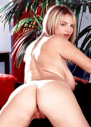 Chubby blonde pornstar Kelly Kay baring huge hooters and ass in high heels