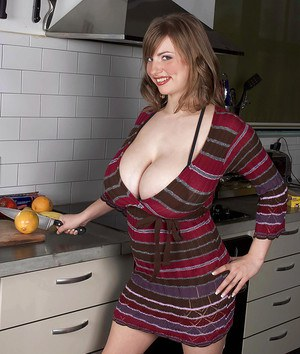 Chesty babe Christy Marks exposing pussy in kitchen after panty removal