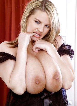 Chubby blonde pornstar Kelly Kay showing off huge saggy boobs and nipples