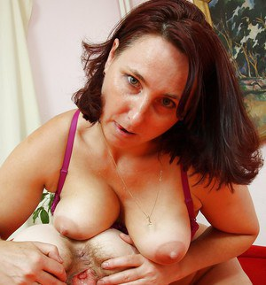 Older dykes spread each others hairy pussy for licking and toying