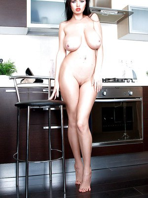 Euro brunette Sha Rizel baring large juggs and ass in kitchen