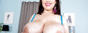Chesty plumper Allie Pearson licks own nipples while spreading shaved pussy