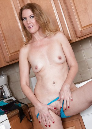 Mature housewife Lacy baring tiny tits and spreading hairy pussy in kitchen
