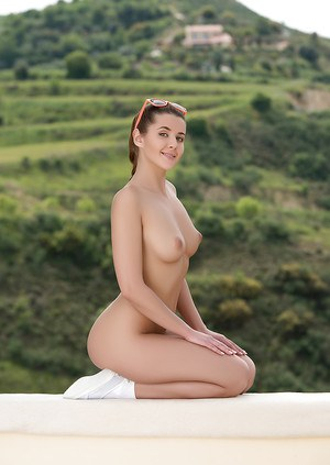 Centerfold babe Kailena showing off perfect tits and shaved pussy outdoors