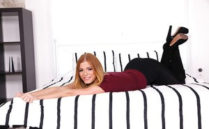 Redhead first timer Chrissy posing for solo girl shoot in long black boots