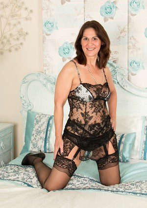 Stocking clad aged dame Kaysy spreading hairy pussy after ditching lingerie