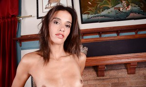 Aged brunette Khloe Kash bares small tits and shaved pussy for masturbation