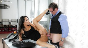 Busty high heeled Asian pornstar Asa Akira giving blowjob in office